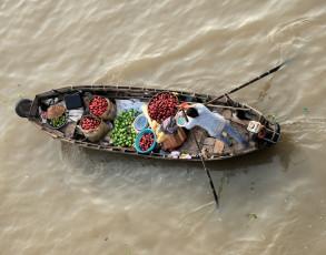 Schwimmender Händler in Cai Be